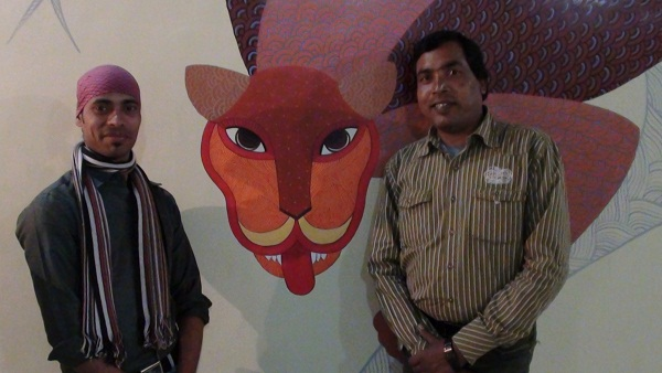 The artists Mr. Venkat and his colleague proudly displaying their creation