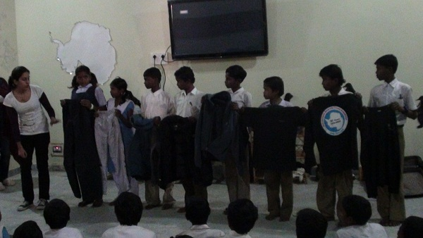 Chandini showing the studnets the kind of clothes that are to be worn in the Antarctic