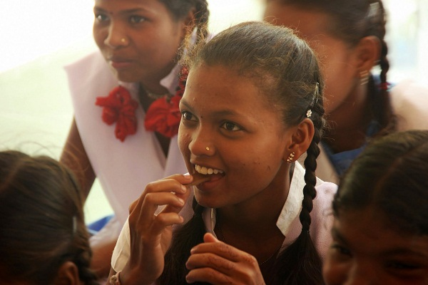 Smelling and then biting into the chocolate to understand how the digestive process starts at the point of salivation.