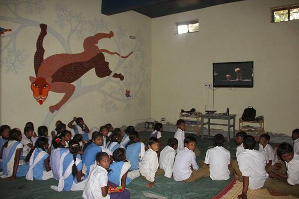 Kohka Middle School students intently watching 'Delhi Safari'