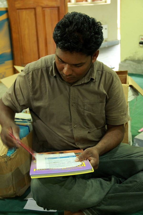 Our Pench Coordinator working hard at sorting and labelling the books for the library.