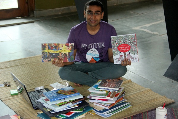 Our volunteer, Jash Koradia, working on labelling and registering the endless number of books.