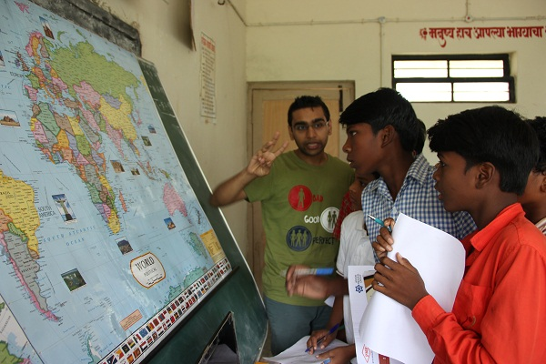 Our volunteer for the week, Jash Koradia, identifying with the students countries in which the tiger roams in the wild.