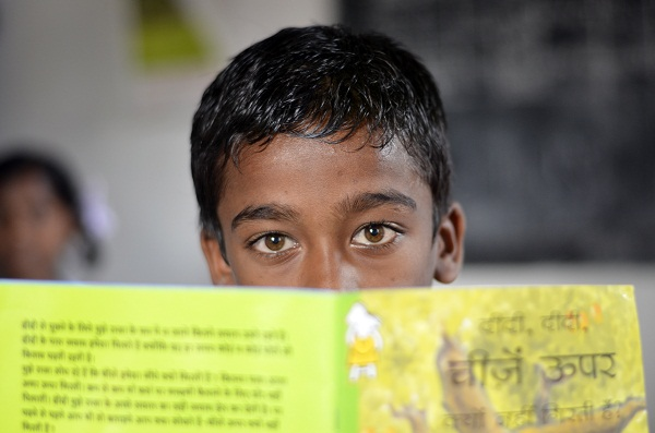 One of our students with lovely eyes was just asking to be photographed. Unfortunately, his reading skills didn't even touch Reading Level 1. (Image: Monica Szczupider)