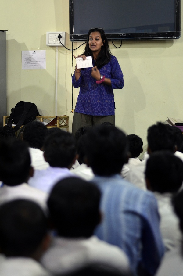 Our program manager, Pooja, explaining the library rules to the students.