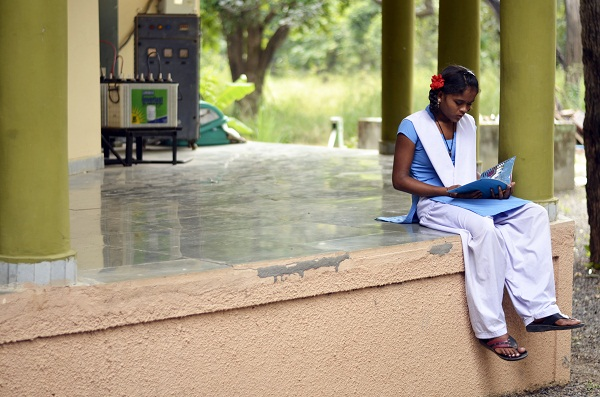 One of our students from Kohka Middle School, Manisha, preferred to step away from the crowd and quietly read her library book as she waited for her pick up to go back to school.