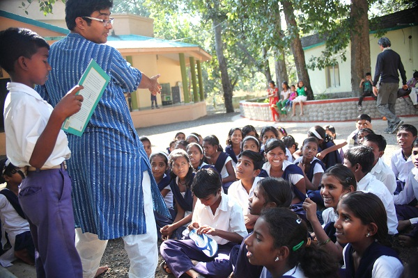 Vikram performing the story 'Jadui Macchi' for the students.