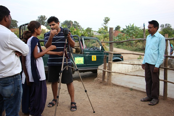 Interviewing villagers for the film.
