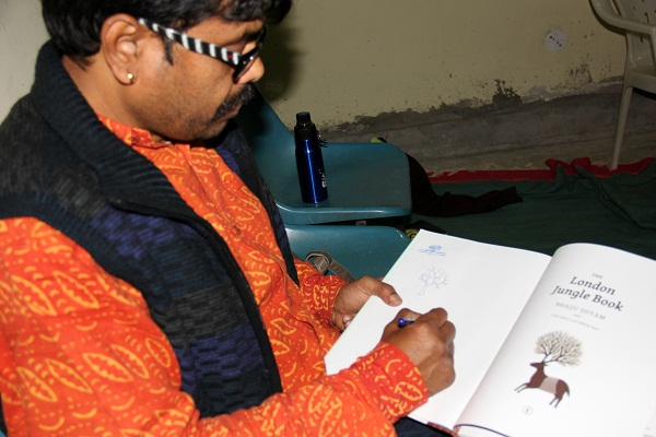 Bhajju ji autographing his books at the E-Base.
