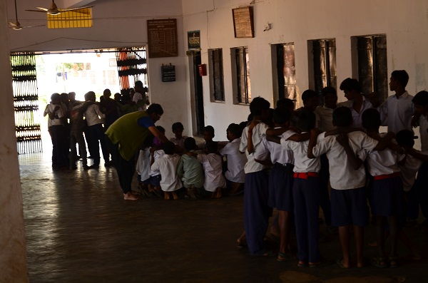 Vikram working with different groups of students.