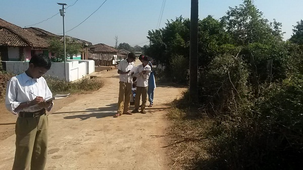 Students in the village of Kohka conducting the pollution survey.