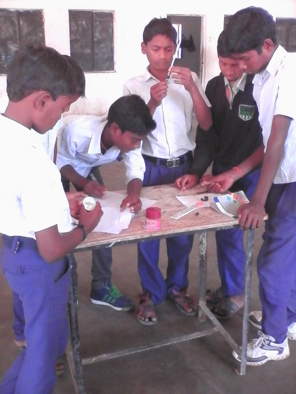 Boys working on a model of electromagnetism.