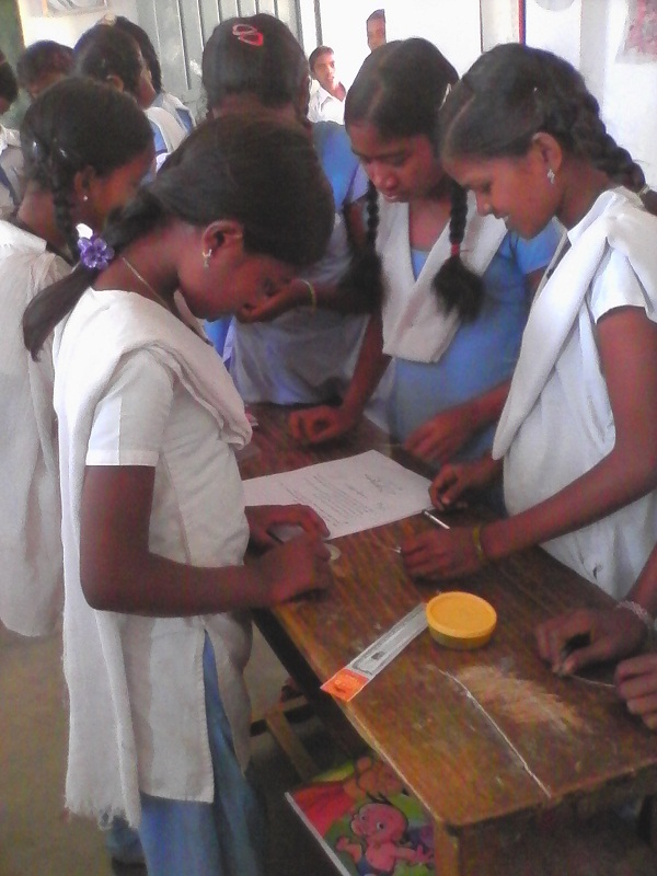 Students trying their had at various experiments in the workshop.