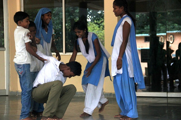 Our student, the 'drunk uncle' getting a hand from other 'villagers'.